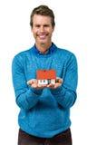 Portrait of smiling man holding model house Stock Image