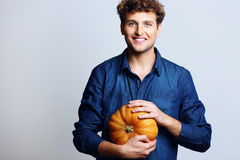 Portrait of a smiling man holding pumpkin Stock Photography