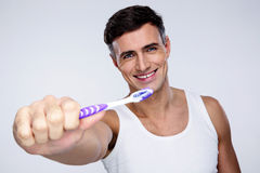 Portrait of a smiling man holding toothbrush Stock Photo
