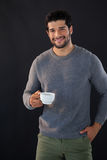 Portrait of smiling man holing a cup of tea Stock Photo