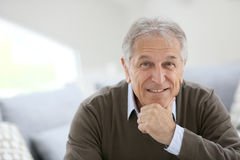 Portrait of smiling man at home Stock Photo