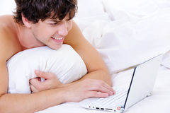 Portrait of a smiling man with laptop Royalty Free Stock Images