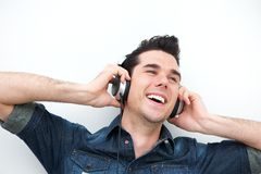 Portrait of a smiling man listening to music on headphones Royalty Free Stock Photo