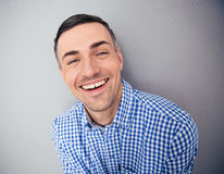 Portrait of a smiling man looking at camera Stock Photos