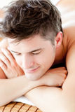 Portrait of a smiling man lying on a massage table Stock Photo