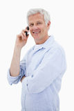 Portrait of a smiling man making a phone call while looking at t Stock Photography