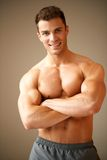 Portrait of smiling man with muscular arms Stock Images