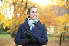 Portrait of a smiling man outside on a fall day. Close up portrait of a smiling man outside on a fall day stock photos