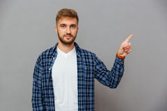 Portrait of a smiling man pointing finger up Royalty Free Stock Photo