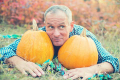 Portrait of a smiling man with pumpkins Royalty Free Stock Photography