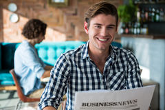 Portrait of smiling man reading a business newspaper Royalty Free Stock Image