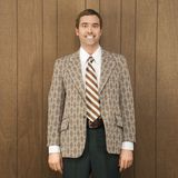 Portrait of smiling man in retro suit Stock Photos
