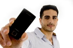 Portrait of smiling man showing mobile Stock Photos
