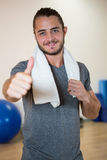 Portrait of smiling man showing thumbs up Stock Image