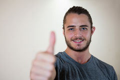 Portrait of smiling man showing thumbs up Royalty Free Stock Image