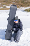 Portrait of smiling man with snowboard Stock Image