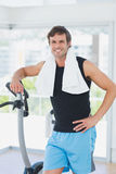 Portrait of a smiling man at spinning class in bright gym Stock Photo