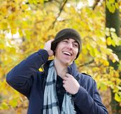 Portrait of a smiling man standing outdoors with hat Royalty Free Stock Photo