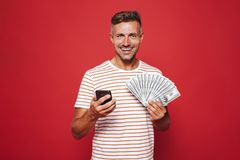 Portrait of a smiling man standing over red background stock image