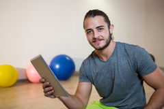 Portrait of smiling man using digital tablet Royalty Free Stock Photos