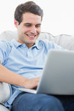 Portrait of a smiling man using his laptop stock photos