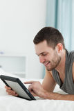 Portrait of a smiling man using a tablet computer  Royalty Free Stock Photos