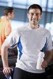 Portrait of smiling man with water bottle in health club. Portrait of smiling men with water bottle in health club Stock Images