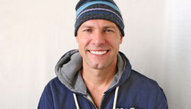 Portrait of the smiling man wearing a knitted hat Stock Image