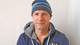 Portrait of the smiling man wearing a knitted hat Royalty Free Stock Photography