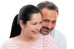 Portrait of couple hugging. Portrait of smiling men and women couple hugging as romantic concept isolated on white background royalty free stock photo