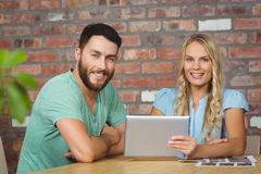 Portrait of smiling man and woman with digital tablet Royalty Free Stock Image