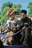 Portrait of smiling man and woman in historical costumes. Royalty Free Stock Photography