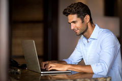 Portrait of smiling man working on laptop Royalty Free Stock Images