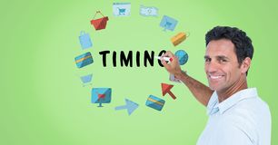 Portrait of smiling man writing timing surrounded by various icons Royalty Free Stock Image