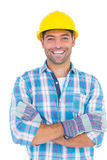 Portrait of smiling manual worker with arms crossed Stock Images