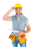 Portrait of smiling manual worker holding clipboard. Over white background stock photos