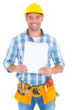 Portrait of smiling manual worker holding clipboard Stock Photography