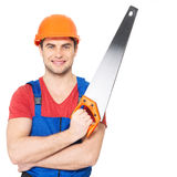 Smiling manual worker with saw Stock Photography
