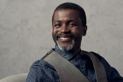 Portrait of smiling mature african american man. In waistcoat stock photos