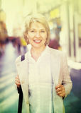 Portrait of smiling mature blond woman  in town Royalty Free Stock Image