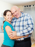 Portrait of smiling mature couple  in home Royalty Free Stock Image