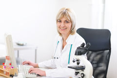 Portrait of smiling mature doctor woman at lab Royalty Free Stock Photo