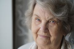Portrait of smiling mature elderly woman aged 80s. Indoors. Close-up royalty free stock photo