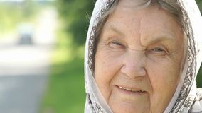 Portrait of smiling mature elderly woman. Close-up stock video