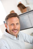 Portrait of smiling mature man in office Royalty Free Stock Photography