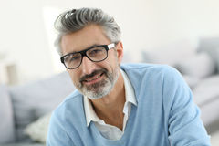 Portrait of smiling mature man wearing glasses Stock Photo