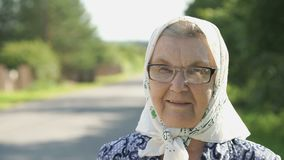 Portrait of smiling mature old woman in glasses stock video