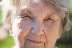 Portrait of smiling mature old woman outdoors Royalty Free Stock Images