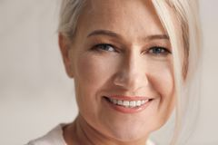 Portrait of smiling mature woman at home, Stock Image