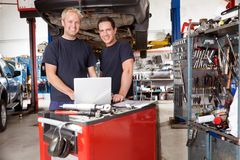 Portrait of smiling mechanics Royalty Free Stock Images